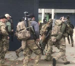 Training at the venue began with an impromptu call out exercise, with officers dressing out and racing to the scene. (Photo/Mike Wood)