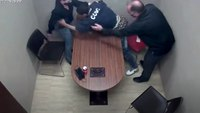 Watch: Confessed killer lunges for cop's gun in interview room