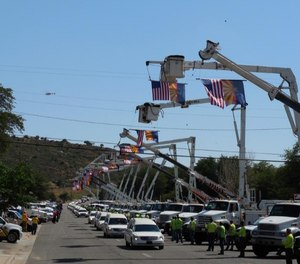 The funeral procession of the Granite Mountain Interagency Hotshot firefighters who lost their lives suppressing the Yarnell Fire passes through Yarnell, Arizona, on July 9, 2013.