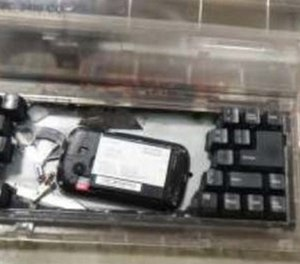 Investigators provided a photo of the cellphone hidden inside the typewriter.