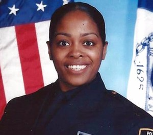 This undated photo provided by the New York Police Department shows officer Miosotis Familia, who was shot to death early Wednesday, July 5, 2017, ambushed inside a command post RV by an ex-convict, authorities said. The gunman was killed by police about a block away. (NYPD via AP)