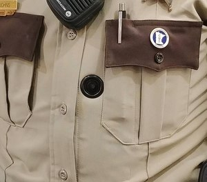 Olmsted County Sheriff's Deputy Heather Johns displays the office's BodyWorn cameras. (image/Emily Cutts, Post Bulletin)
