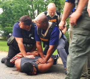 Officers arrest suspect Cory Godbolt on Sunday, May 28, 2017, following several fatal shootings Saturday in Lincoln County, Miss., officials said. (Therese Apel/The Clarion-Ledger via AP)