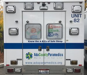 An Ada County Paramedics ambulance with the ABC's Safe Infant Sleep campaign.