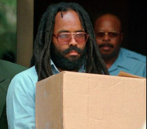 In this July 12, 1995 file photo, Mumia Abu-Jamal leaves Philadelphia's City Hall after a hearing. (AP Photo/Chris Gardner, File)