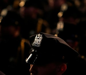 New graduates of the Police Academy participate in a graduation ceremony in New York, Wednesday, Dec. 28, 2016.
