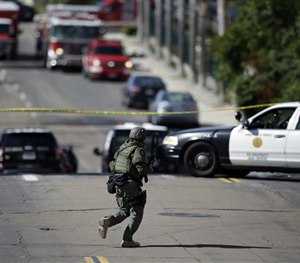 A San Diego police officer patrols a neighborhood in San Diego on Wednesday, Nov. 4, 2015.