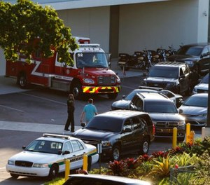 Police and rescue vehicles are shown outside Broward Health North hospital, Wednesday, Feb. 14, 2018, in Deerfield Beach, Fla.