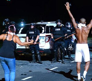 Protesters approach police in Charlotte, N.C., Tuesday, Sept. 20, 2016. (Jeff Siner/The Charlotte Observer via AP)