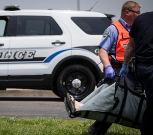 Emergency personnel carry a volunteer to a triage staging area during a training exercise for an active shooter with simulations at Hopewell Elementary School, Wednesday, May 25, 2016, in West Chester, Ohio.