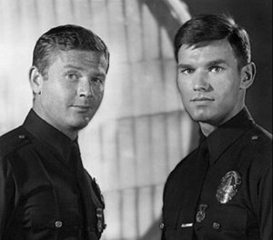 Adam-12 was about two LAPD police officers, veteran Pete Malloy played by Martin Milner (left) and rookie Jim Reed, played by Kent McCord.