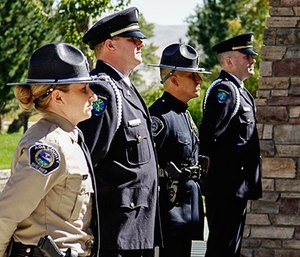 Ada County Paramedics Honor Guard members Robert Vander Stelt and Chris Ehrman stand with Ada County Sheriff representatives in a memorial cordon for Ada County Paramedics Donna Seller's memorial service (Photo by Andrea Cobler)