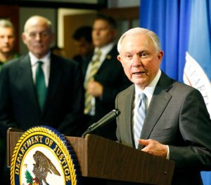 Attorney General Jeff Sessions, right, speaks as Homeland Security Secretary John Kelly listens after the pair toured the ports of entry and met with Department of Justice and DHS personnel in El Paso, Texas, Thursday, April 20, 2017. (Ruben R. Ramirez/The El Paso Times via AP)