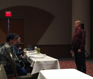Rick Barney, MD is pictured speaking to attendees on addiction as a brain disease at Wis. EMS Association Conference.