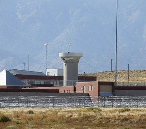 This Thursday, Oct. 15, 2015 file photo shows a guard tower looming over a federal prison complex which houses a Supermax facility outside Florence, in southern Colorado.