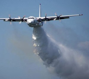 In this undated photo released from the Rural Fire Service, a C-130 Hercules plane called