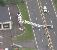 Pa. aerial tower flying American flag overturns onto roadway