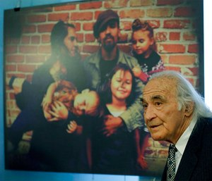 Attorney Tony Serra, representing Derick Almena, speaks during a media conference beside a photograph of the Almena family. (AP Photo/Ben Margot)