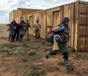 Emergency medical technicians carry a simulated patient as part of the Commando Challenge during the 2016 EMT Rodeo at Melrose Air Force Range, N.M., Aug. 25, 2016. (U.S. Air Force Photo/Senior Airman Luke Kitterman)