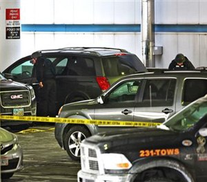 Members of the bomb squad check out a parked SUV at port Columbus Airport on Wednesday, Jan. 7, 2015. (AP Image)