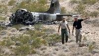 Pilot survives vintage military jet fire near Nev. airport