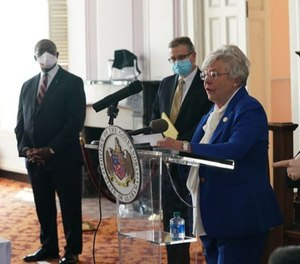 Gov. Kay Ivey announces the state's stay-at-home order on April 28, 2020. Sheriffs across Alabama have taken different approaches to enforcement, from refusal to enforcement to education or citation. (Photo/TNS)