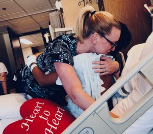 Nurse Alexis Skjelbred with a patient. Skjelbred was a recipient of the Spokane Valley Fire Employees Scholarship, which is funded by firefighter donations, and went on to become a nurse who treats many of the firefighters who assisted her.
