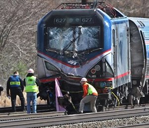 Amtrak investigators inspect the deadly train crash in Chester, Pa. The Amtrak train struck a piece of construction equipment just south of Philadelphia causing a derailment. (Michael Bryant/The Philadelphia Inquirer via AP)