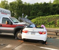 Ambulance transporting 7-month-old collides with car