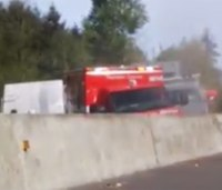 Watch: Wash. ambulance struck by truck en route to crash