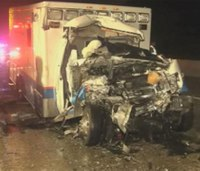 Fatal collision after ambulance rear-ends cement truck