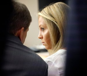 Former Dallas police officer Amber Guyger listens to her attorney Toby Shook during her trial at the Frank Crowley Courts Building in Dallas, Saturday, Sept. 28, 2019. (Tom Fox/The Dallas Morning News via AP, Pool)