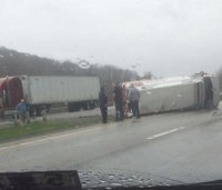 Ambulance overturns on W.Va. interstate; 2 hurt