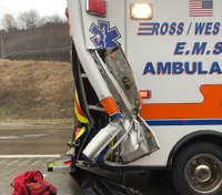 Ambulance struck by tractor-trailer en route to crash scene