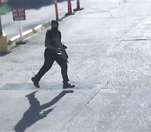 This Sunday, July 17, 2016, frame from security video provided by the Louisiana State Police shows Gavin Eugene Long carrying a weapon in Baton Rouge, La. (AP Image)