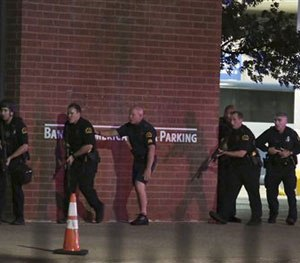 Dallas police respond after shots were fired during a protest over recent fatal shootings by police in Louisiana and Minnesota, Thursday, July 7, 2016, in Dallas.