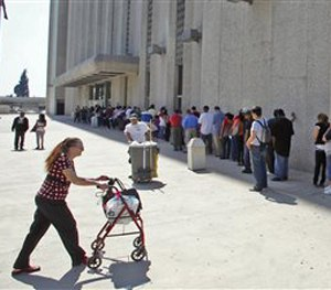In this March 18, 2010 file photo, people line up outside the Metropolitan Courthouse in downtown Los Angeles. (AP Image)