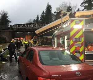 An Amtrak train derailed about 40 miles south of Seattle Monday, spilling at least one train car on to busy Interstate 5. (Photo/Pierce County Sheriff's Office)