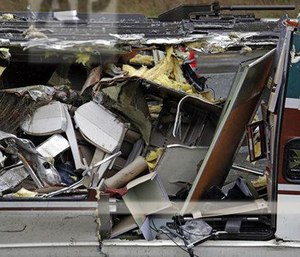 Calls from the train's riders, freeway motorists and witnesses to the deadly wreck flooded the South Sound 911 dispatch center. (Photo/AP)