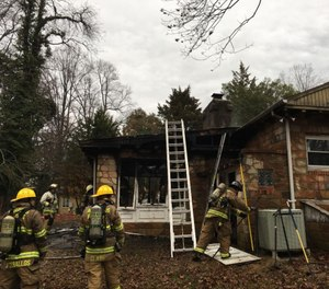 About 30 firefighters responded to a house fire in Highland Beach, Maryland, on Saturday morning. Officials said one firefighter was injured battling the blaze that left one resident displaced. (Photo/Anne Arundel County Fire Department)