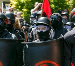 Counter-protesters prepare to clash with Patriot Prayer protesters during a rally in Portland, Ore., Saturday, Aug. 4, 2018. (AP Photo/John Rudoff)