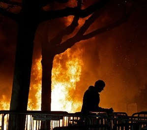 A bonfire set by demonstrators protesting a scheduled speaking appearance by Milo Yiannopoulos, Feb. 1, 2017, in Berkeley, Calif.