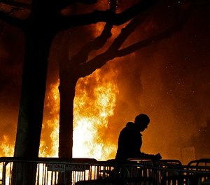 A bonfire set by demonstrators protesting a scheduled speaking appearance by Milo Yiannopoulos, Feb. 1, 2017, in Berkeley, Calif. (AP Photo/Ben Margot)