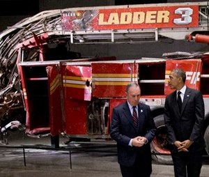 President Barack Obama and former New York City Mayor Michael Bloomberg tour the destroyed Ladder 3 truck at the September 11 Memorial Museum. (AP Photo/Carolyn Kaster)