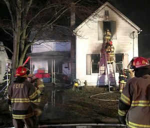 Three young siblings were killed and their mother was hospitalized after she tried to save them from a house fire. (Photo/AP)