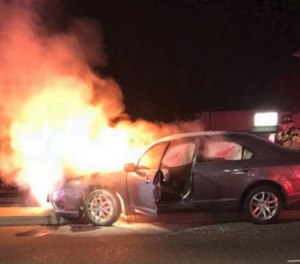 Officer Josh Page removed the driver from the burning car, suffering minor injuries in the process.