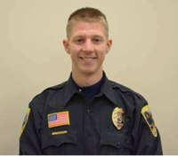 Suspect in Minn. officer shooting fled across roof before firing, complaint says