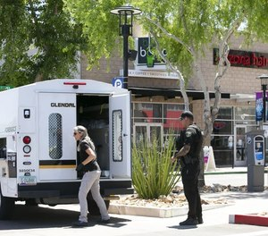 A Glendale police forensics investigator works at the scene of an active shooter situation at the Westgate Entertainment District. (Photo/TNS)
