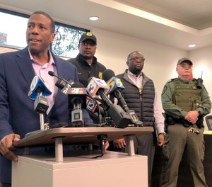 Forrest City, Ark., Mayor Cedric Williams, left, holds a news conference after two police officers were wounded and a gunman was killed in an exchange of gunfire at a Walmart store in eastern Arkansas Monday morning Feb. 10, 2020. (AP Photo/Adrian Sainz)