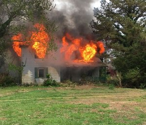 A firefighters organization claimed that fire officials endangered its members by burning a house that contained asbestos. (Photo/Virginia Beach Firefighters Association)
